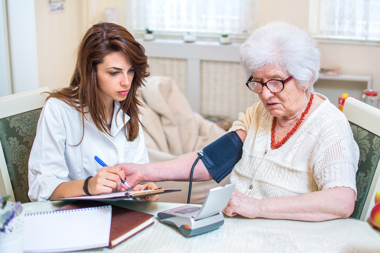 Nurse Practioner checking patient's blood pressure