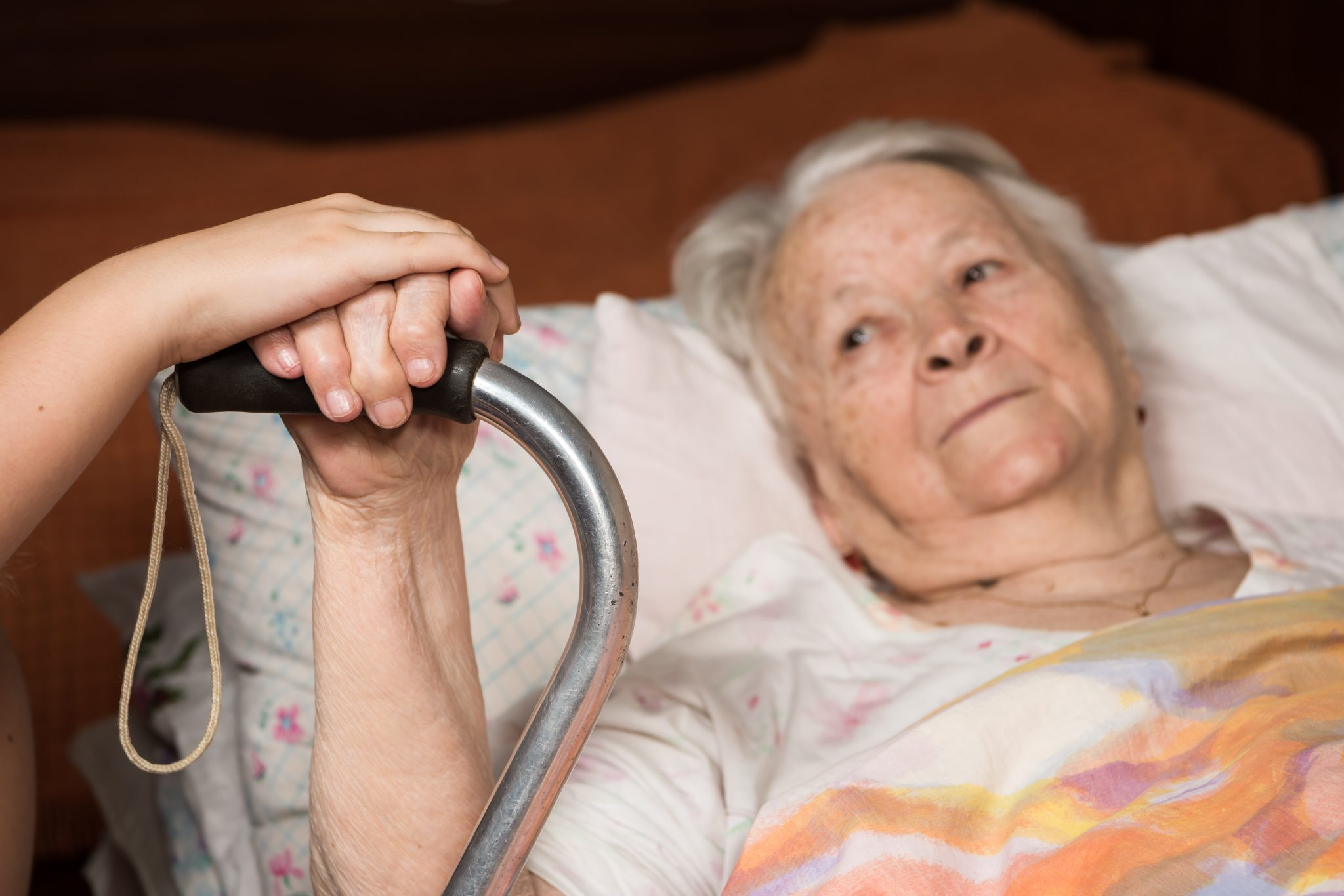 elderly womean in bed with walker